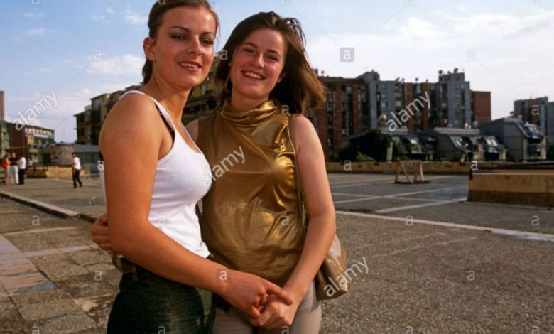 Two women posing on a pavement in Kosovo