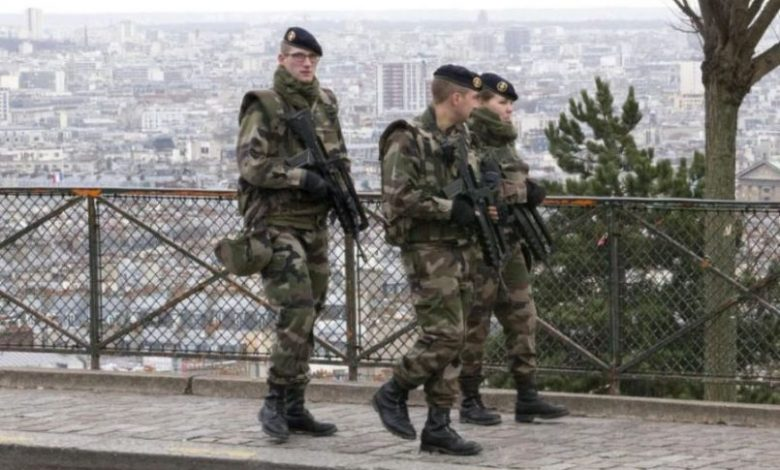 French soldiers patrol on the streets of Paris